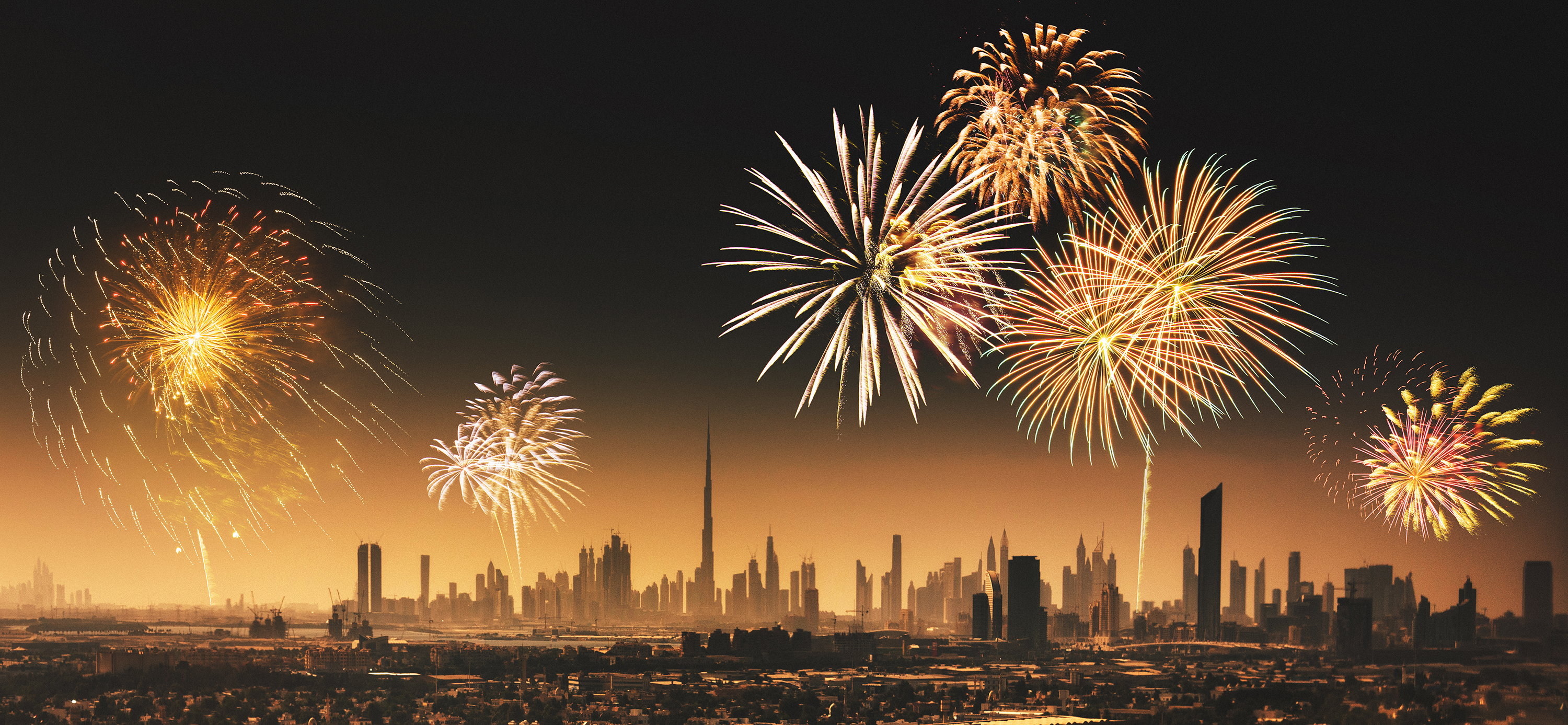 City lights of Dubai downtown with fireworks