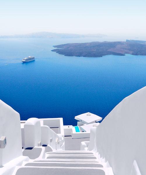 White staircases and Mediterranean sea view on Santorini, Greece